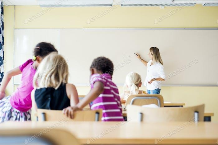 Teacher and children in math class