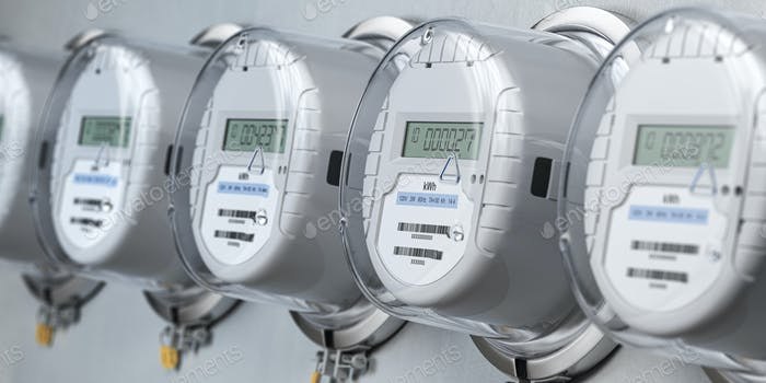 Digital electric meters in a row measuring power use. Electricity consumption concept.