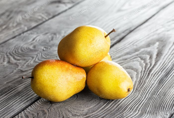 Yellow ripe pear on a table