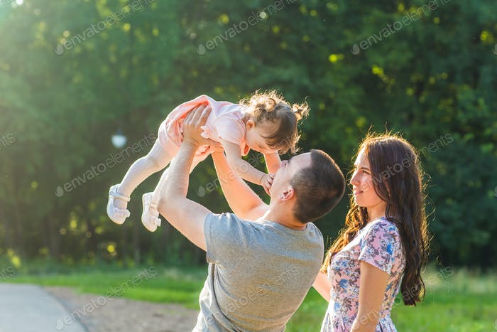 Happy Young Mixed Race Ethnic Family Walking Outdoors