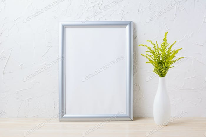 Silver frame mockup with ornamental grass in exquisite vase