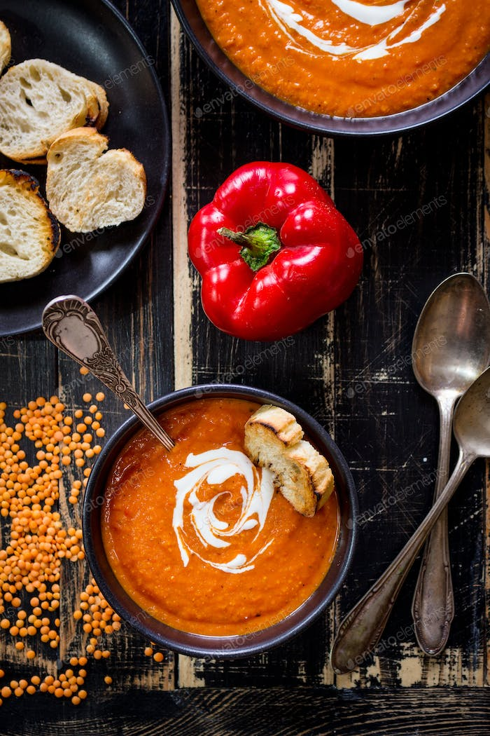 Pumpkin soup with heavy cream and toasts