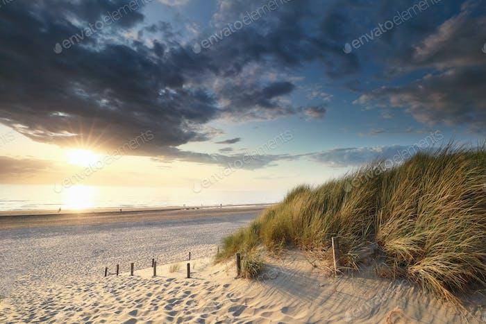 beautiful sunset over sea beach in summer