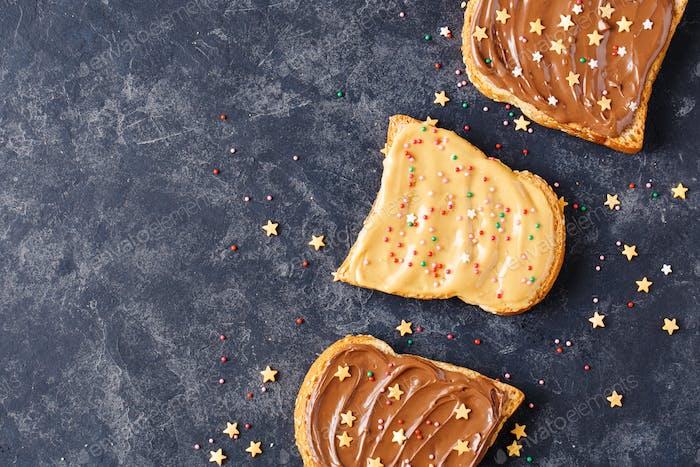 Three toasts with chocolate and peanut cream