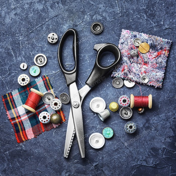 Tailor scissors and buttons