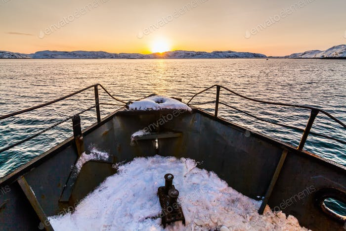 Fishing boat going to sea at winter