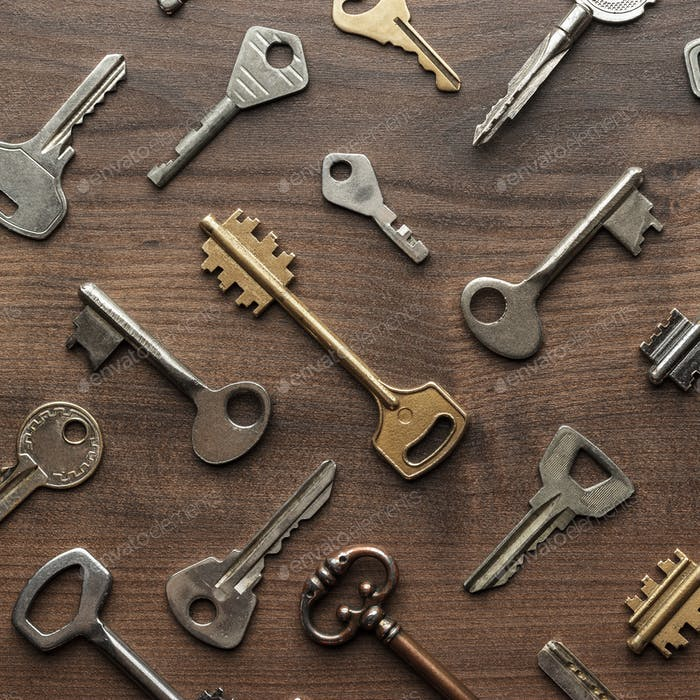 Overhead Of Many Different Keys In Oder On Wooden Background Concept