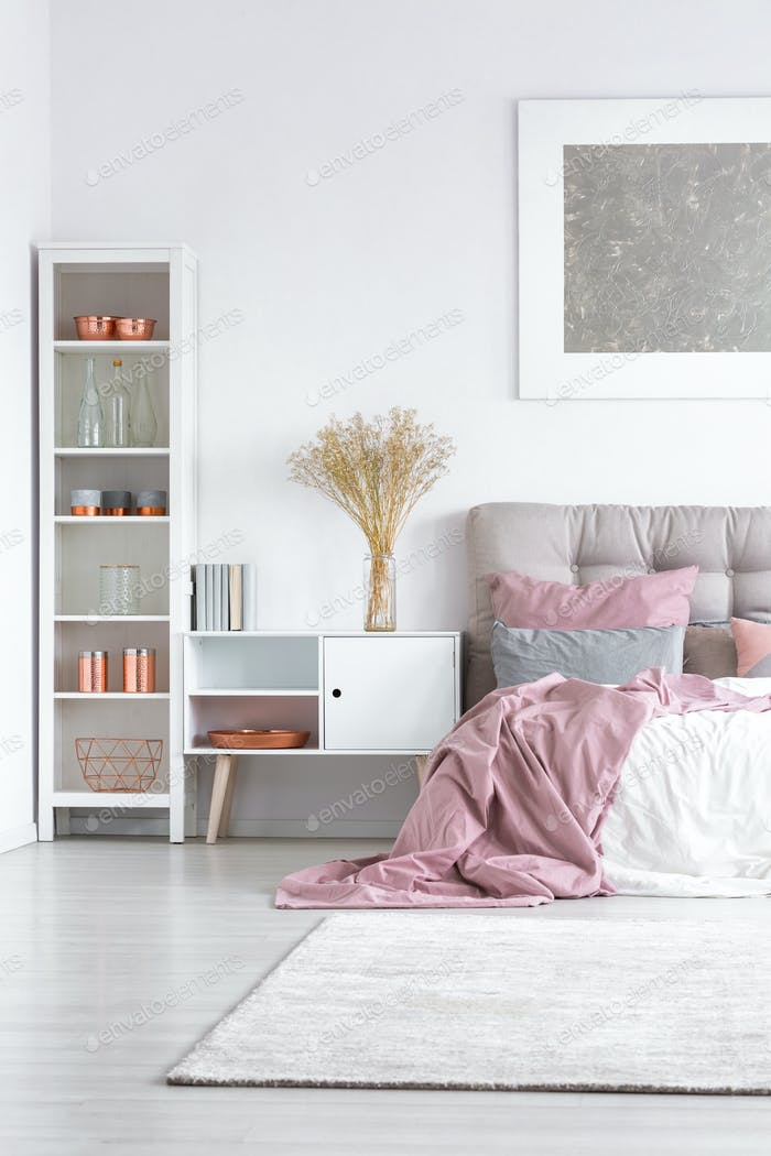 Bed with pastel pink quilt