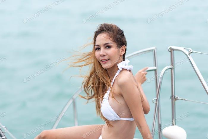 Sexy girl in bikini Having fun in the sun on a cruise ship