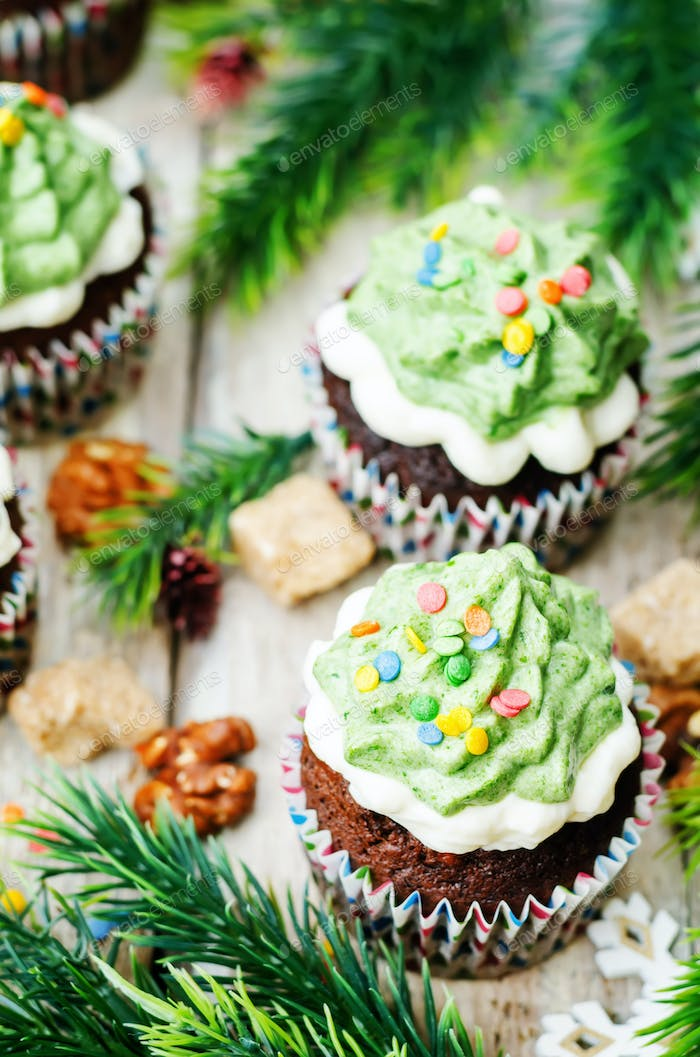 Chocolate cupcakes with green frosting and sprinkles on holiday