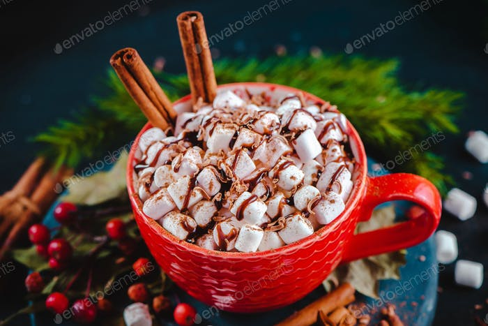 Christmas hot chocolate close-up with marshmallows, chocolate crumbs, and syrup. Large coffee cup