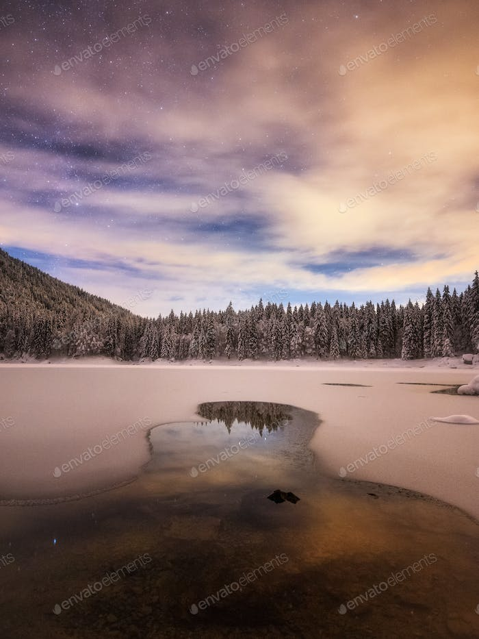 Winter landscape in the mountains by the lake just after the snow storm