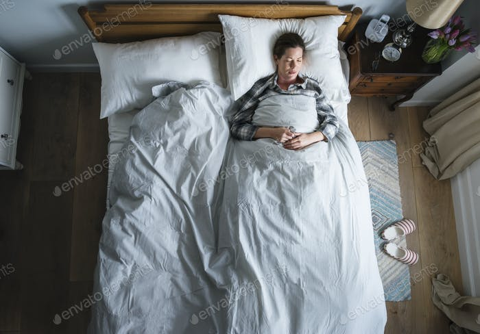 Caucasian woman on bed sleeping