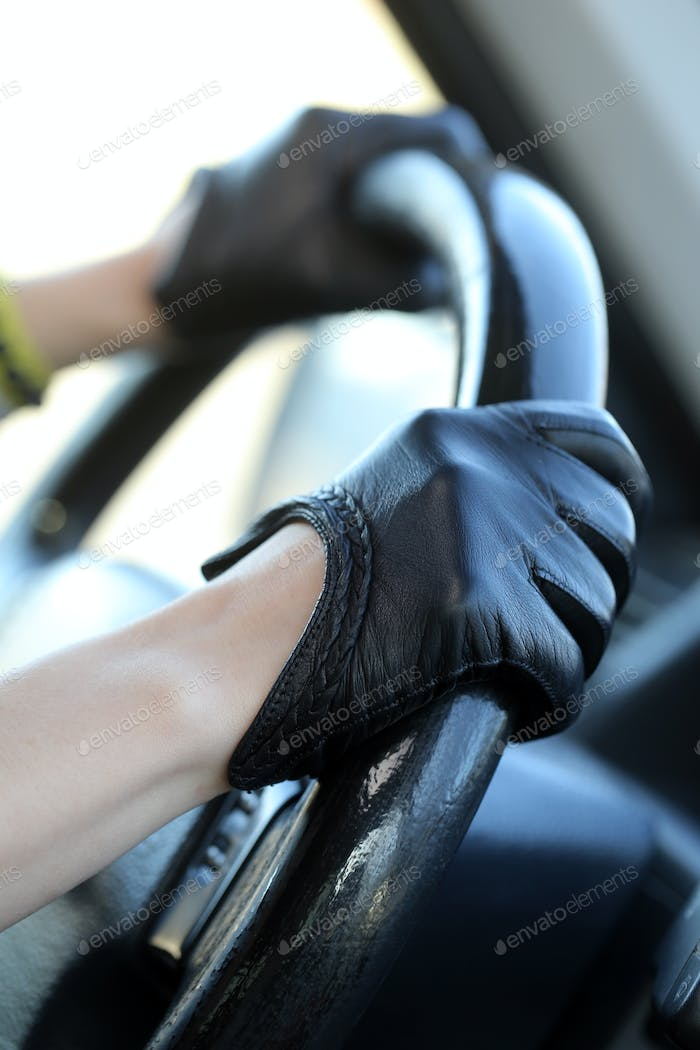 Racer in leather gloves