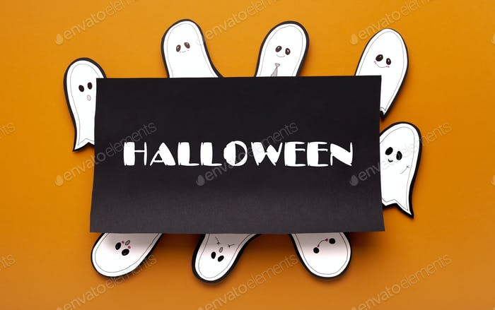 Paper cute ghost celebrating party around black frame