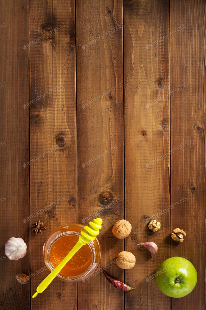 glass jar of honey on wood