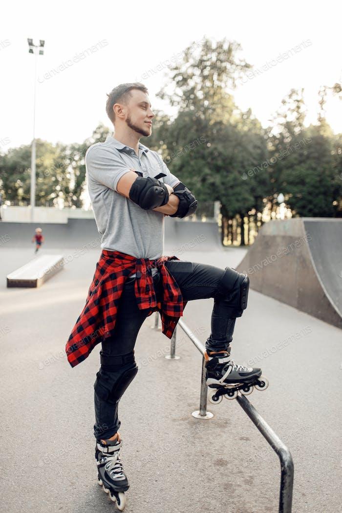 Roller skating, young skater poses in skate park