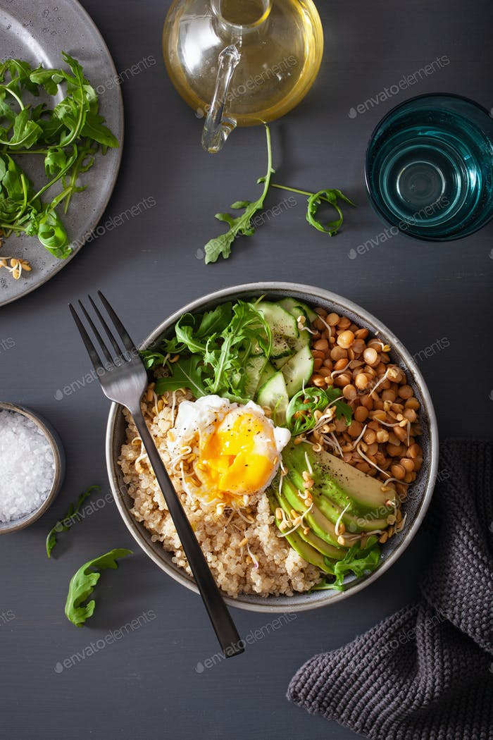 quinoa bowl with egg, avocado, cucumber, lentil. Healthy vegetar