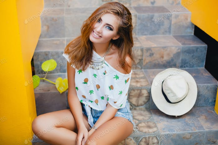 attractive woman in summer style smiling