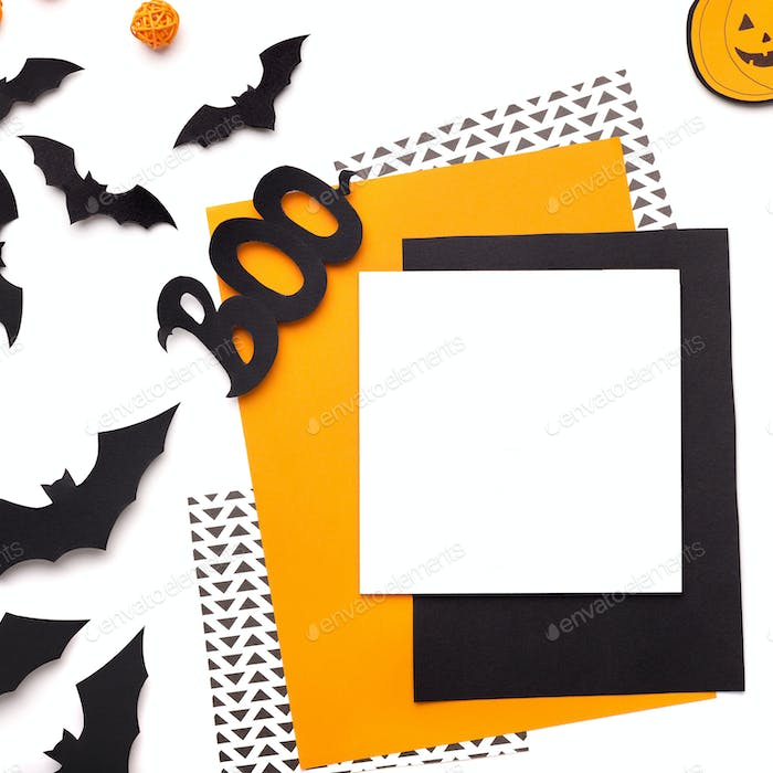 Happy halloween background with colored cardboard papers