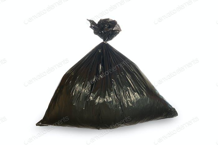 Black trash bag isolated on white