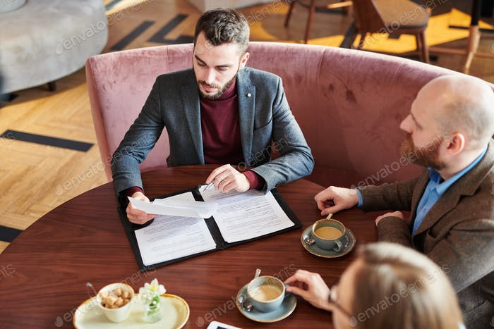 Businessman reading contract with new financial company