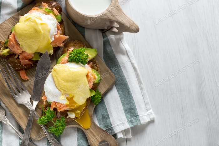 Eggs benedict with salmon background