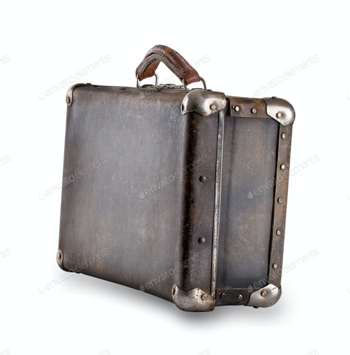 Standing at an angle leather old suitcase
