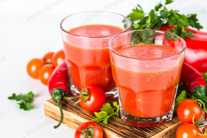 Tomato vegetable juice in glass on white