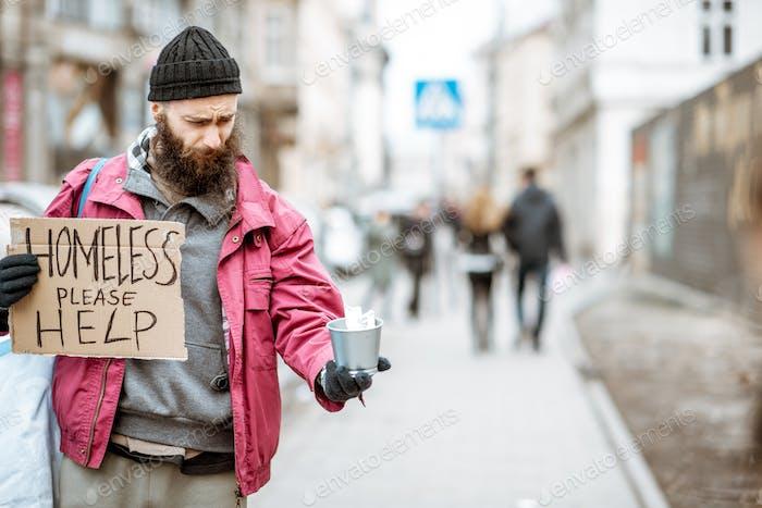 Homeless begging money on the street