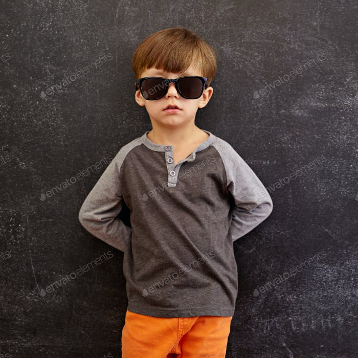 Innocent little kid wearing sunglasses