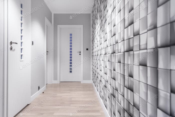 Grey wall in hallway