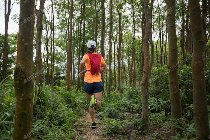 Ultramarathon runner running in tropical rainforest