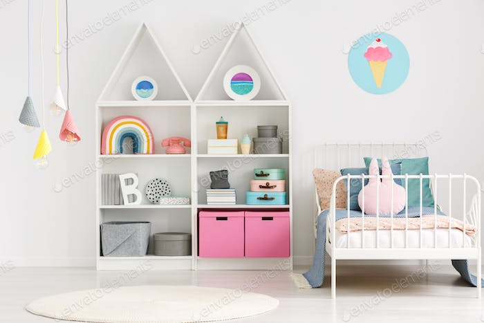 Colorful lamps above rug in modern scandi kid's bedroom interior