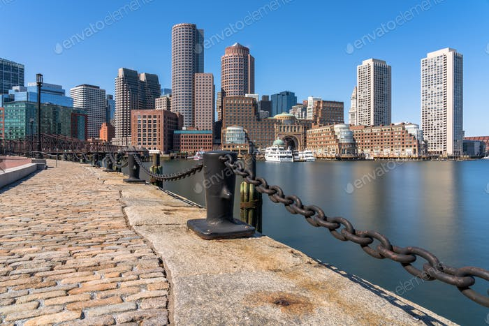 Scene of Boston skyline from Fan Pier at the afternoon with smooth water river, Massachusetts,
