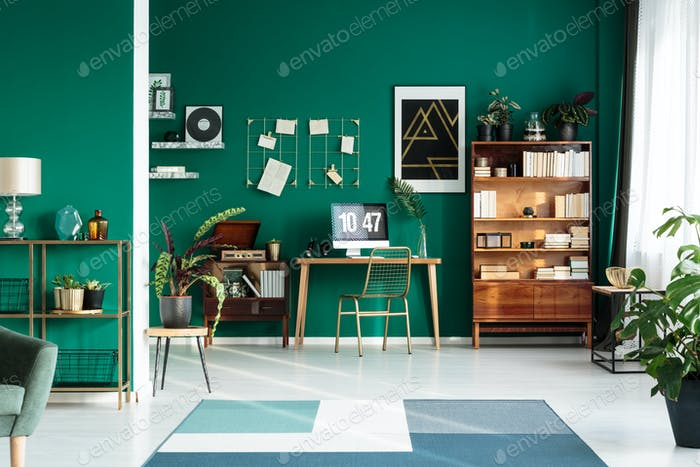 Teal interior with modern workspace