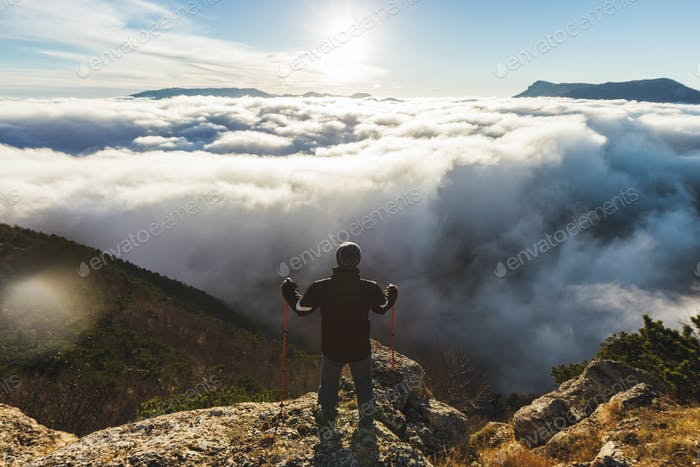 Man looks at the stunning mountain panoramic landscape