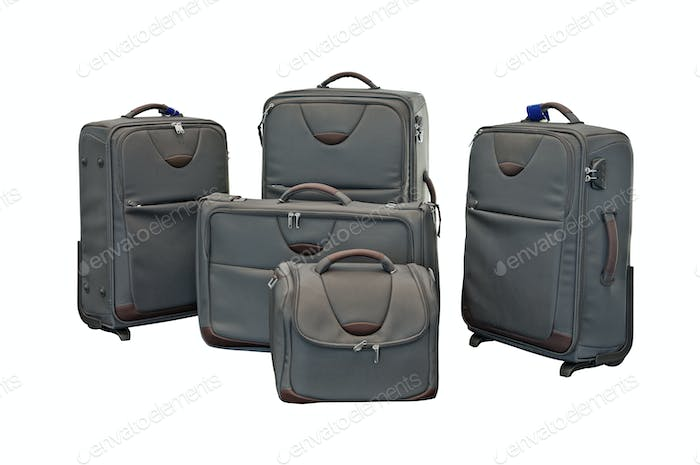 Travel luggage set with airplane in background