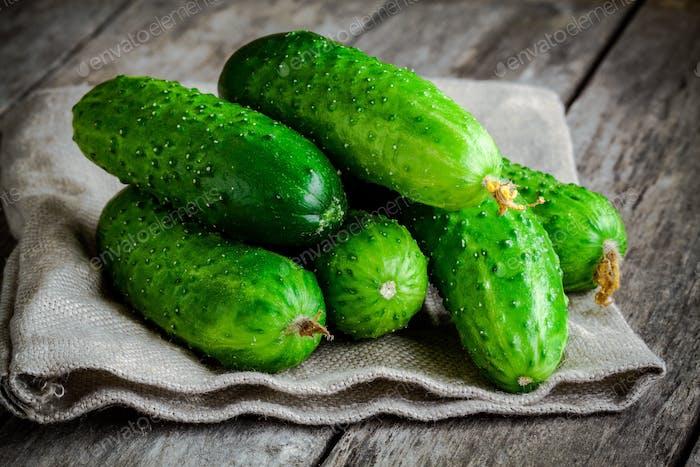 fresh organic cucumbers on sacking