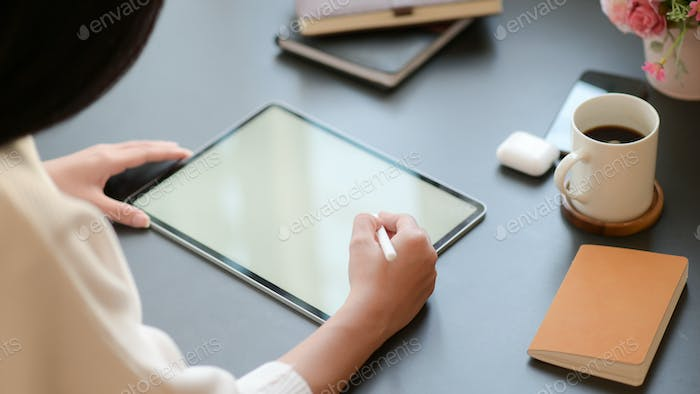 Close-up,Businesswoman is drafting an important program with a tablet for her important project.
