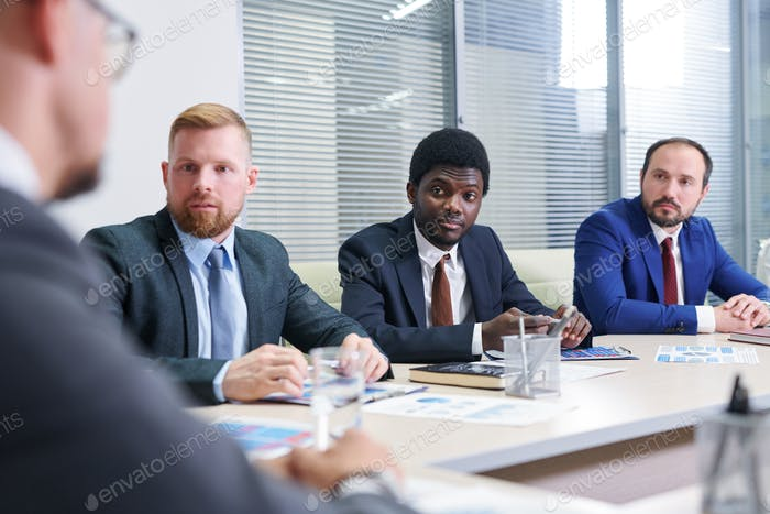 Group of confident financial directors having meeting in boardroom
