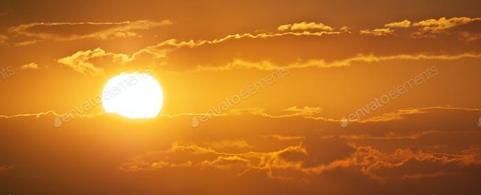 Sunset panorama and big Sun.