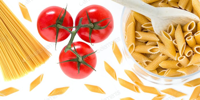 Uncooked raw italian pasta with tomatoes
