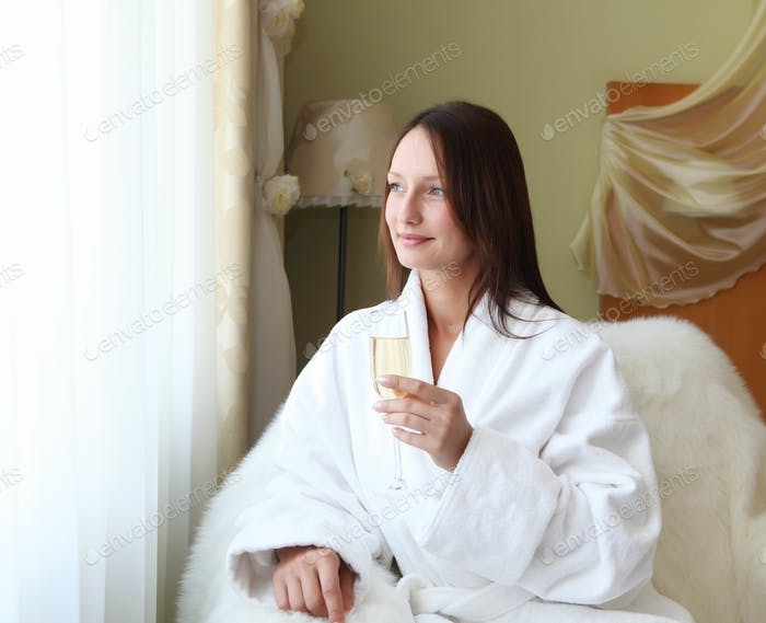 young  woman with glasses of champagne