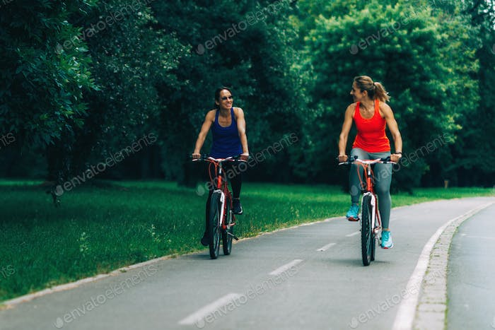 Women Riding Bicycles Together