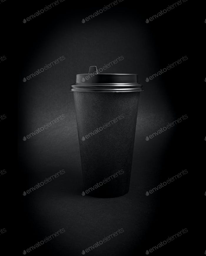 Black Takeaway Paper Coffee Cup over Black Background