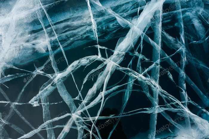 Close up View of Cracks of Frozen Water in Winter