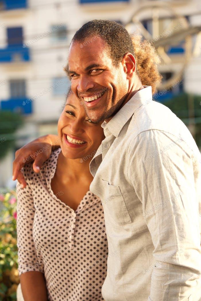 beautiful laughing couple on date walking outside