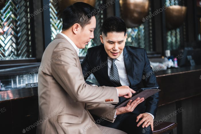 Diversity people of Asian businessman and businesswoman sitting at coffee shop