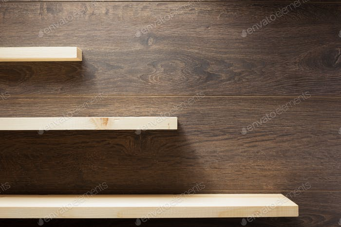 wooden shelf at brown background